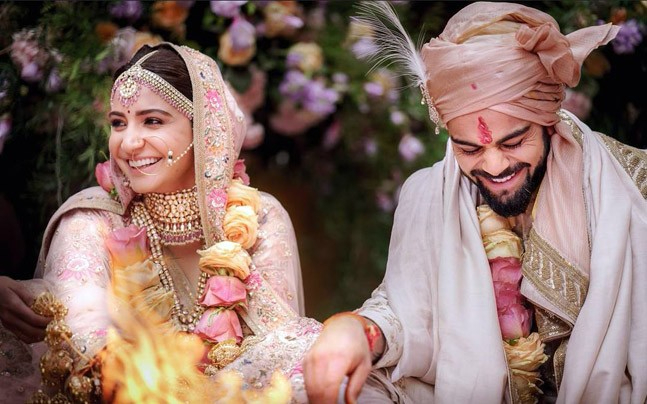 Hooked Virat Kohli and Anushka Sharma begin new innings