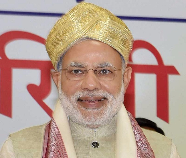 Modi sported a golden turban during his Mysore visit